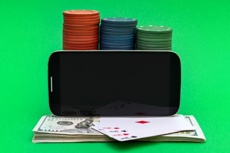 Mobile Poker with poker chips, cards, and money