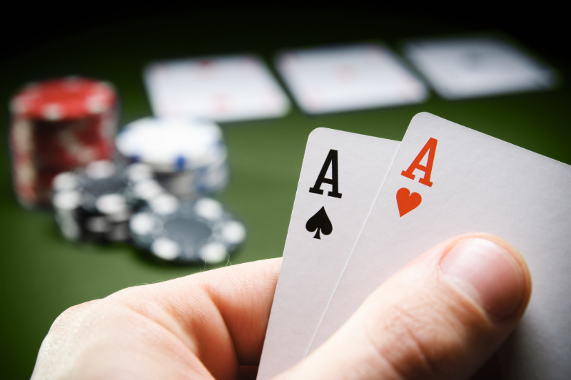 Person playing No Limit Hold'em with pocket aces in their hand